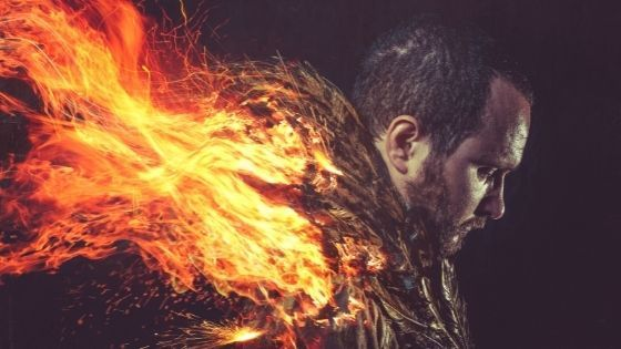 Man with burning fire coming out of back like wings