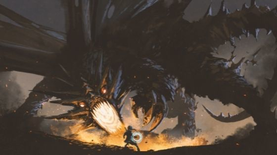 Girl spinning glowing blue object as she faces a giant fire-breathing dragon