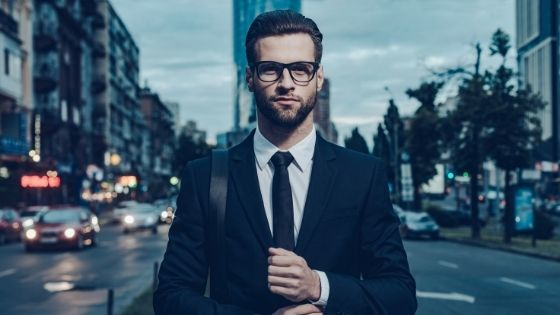 Business man standing in a city